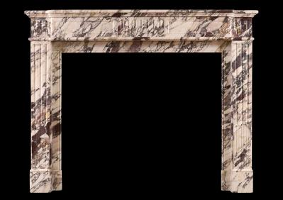 An antique marble fireplace at Olympia