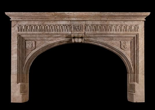 A large Gothic Ham stone antique fireplace