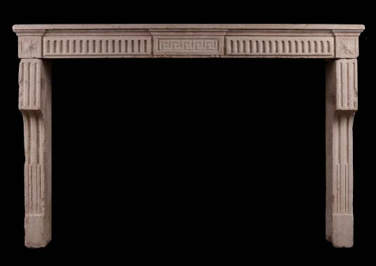 A Period 18th Century Louis XVI stone fireplace with Carved Greek Key and Fluting