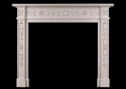 An 18th century style carved white marble mantel piece