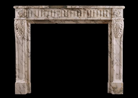 A French Louis XVI fireplace in Serravezza Breccia marble