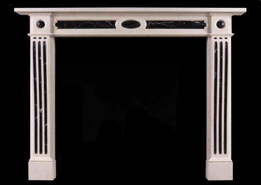 A George III style fireplace in white and black marble
