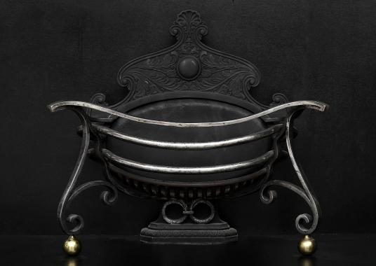 An unusual shaped Art Nouveau wrought iron firebasket