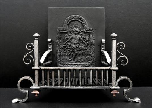A 19th century polished wrought iron firegrate with scrolled legs
