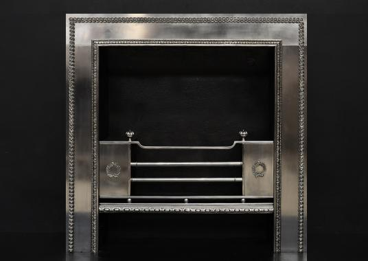 A polished steel Regency style register grate