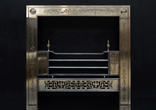 An engraved Irish Georgian style register grate