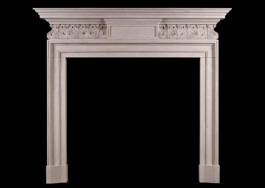 A George II Style Portland Stone Fireplace with carved frieze
