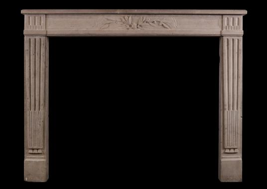 A Louis XVI style limestone antique fireplace