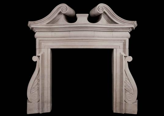 A dramatic English Portland Stone Fireplace in the Palladian manner