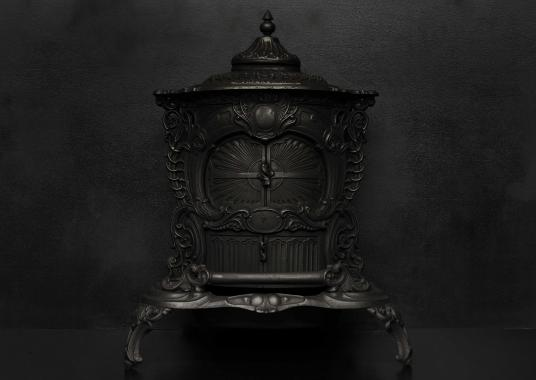 A decorative cast iron stove