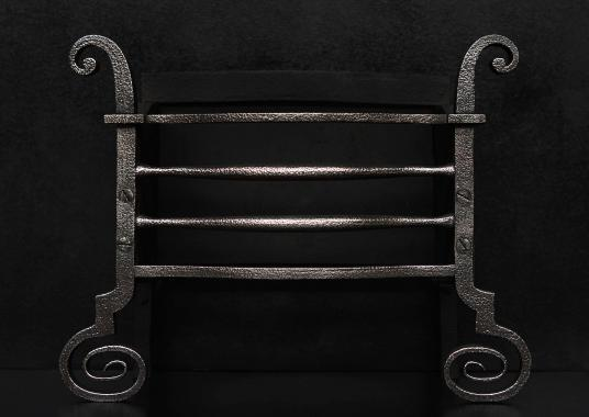 A 19th century wrought iron firebasket