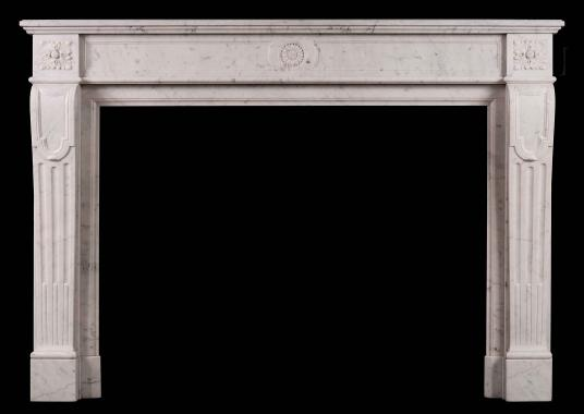 A 19th century French Carrara antique marble fireplace in the Louis XVI style