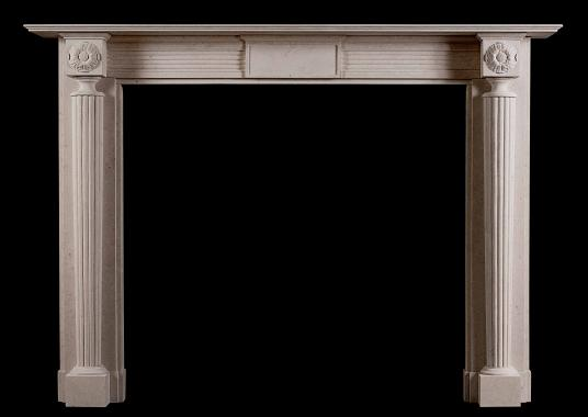 An English, Regency style fireplace in limestone