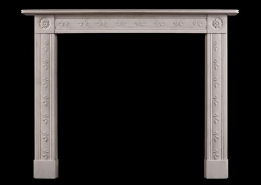 A delicate English Regency white marble fireplace