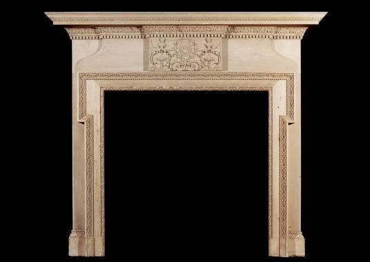A mid 19th century antique English carved pine fireplace