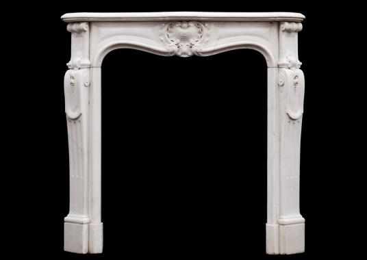 A petite French Louis XV style Statuary marble fireplace