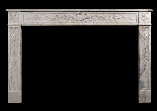 An 18th century French Louis XVI veined white marble fireplace