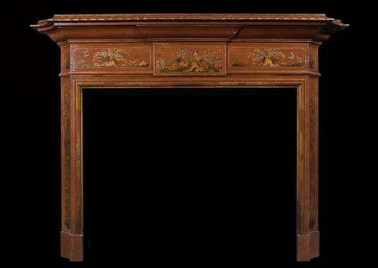 A 19th century English Japanned wood fireplace