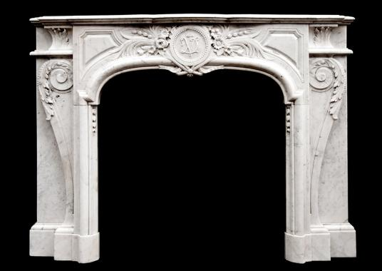 An attractive Louis XIV style Carrara marble chimneypiece