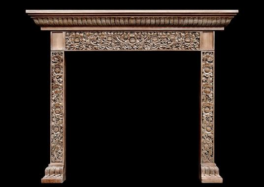 A heavily carved hardwood fireplace with an Oriental influence