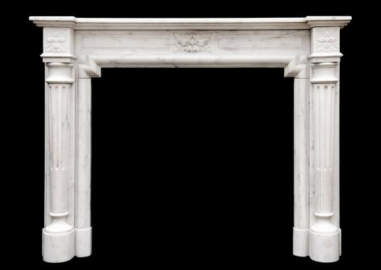A French Louis XVI style fireplace in Statuary marble