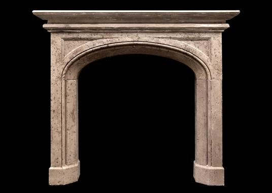 A 19th century English Gothic style stone fireplace