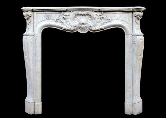 A French Carrara marble Louis XV style fireplace