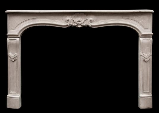 An 18th century Louis XV Caen stone fireplace