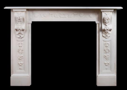 A well carved Victorian English Statuary marble fireplace