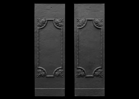 A pair of cast iron interior panels