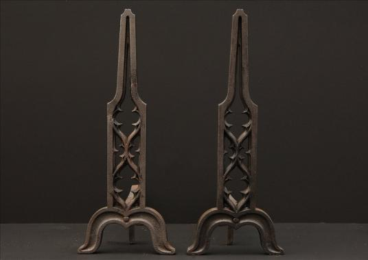A pair of Gothic Revival cast iron firedogs