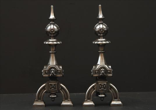 A pair of neo gothic steel firedogs