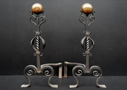 A pair of arts and crafts wrought iron firedogs