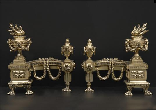 A very fine pair of decorative brass chenets