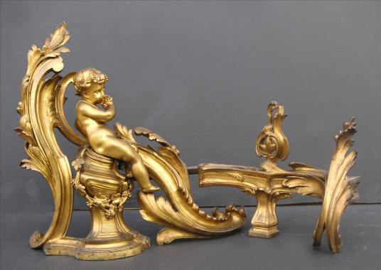 An impressive pair of 18th century Louis XV brass chenets
