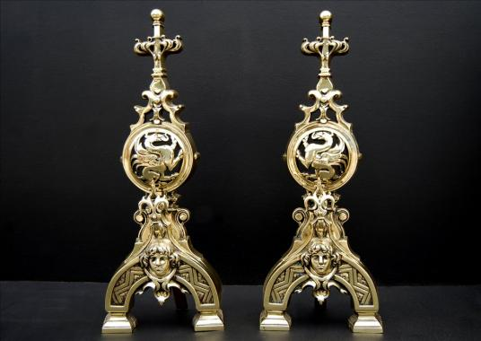 An impressive pair of French polished brass firedogs