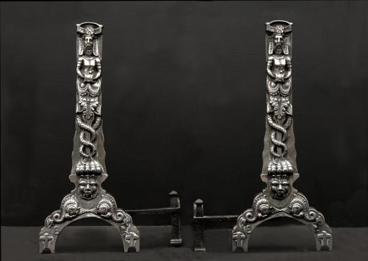 A pair of cast iron firedogs in the Baroque style