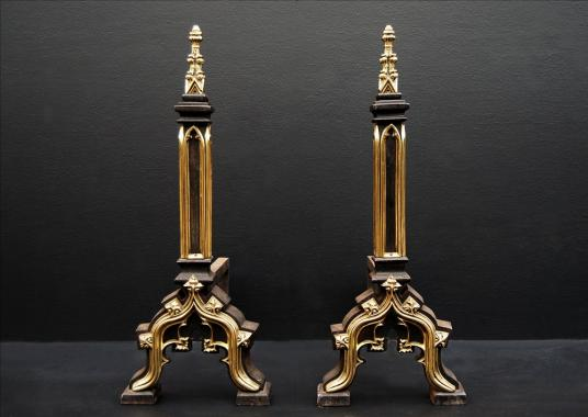 A pair of Gothic revival firedogs in the manner of Augustus Pugin