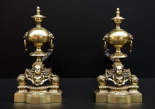 A pair of french brass firedogs