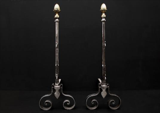 An elegant pair of english firedogs with brass acorn finials