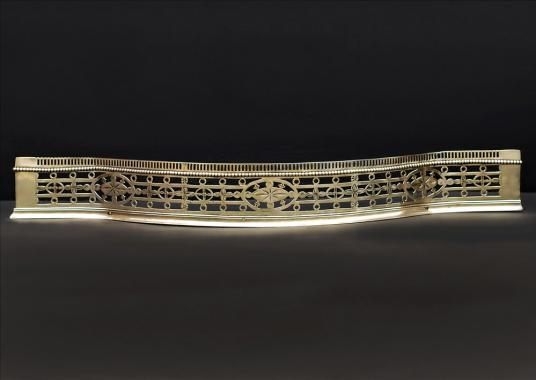 An 18th century engraved antique brass fender