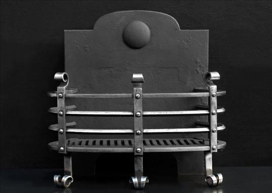 A well proportioned polished steel firebasket