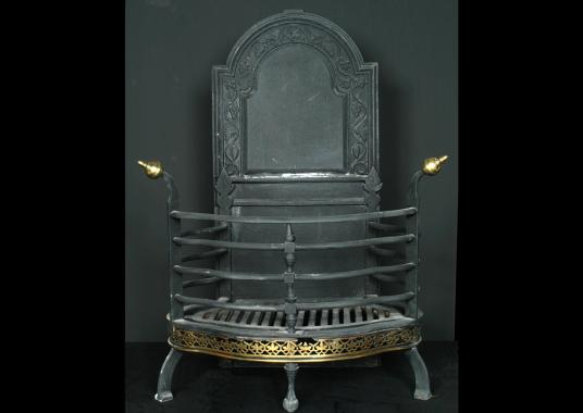 A 19th century cast iron Dutch basket grate