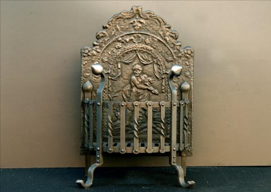 A 19th century wrought iron firegrate with decorative cast fireback