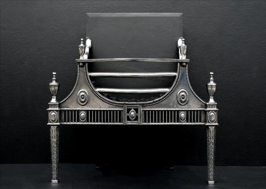 A Georgian style polished cast iron firebasket