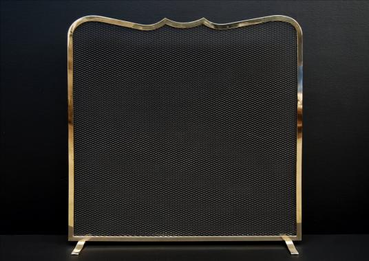 An elegant brass firescreen
