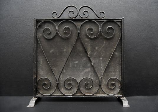 A small wrought iron firescreen
