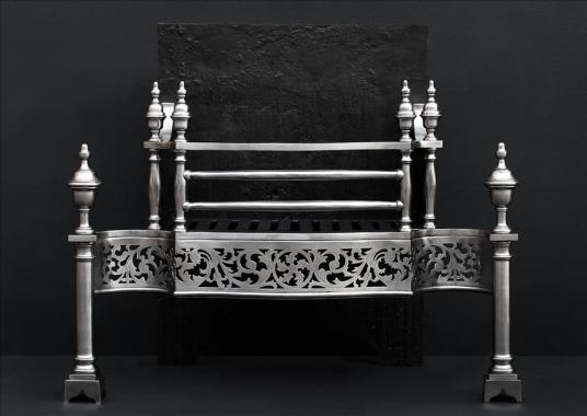 A steel firegrate in the manner of Thomas Chippendale