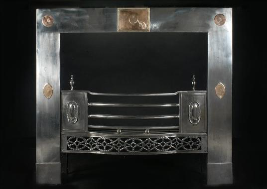 A 19th century English steel Register grate with gunmetal detailing