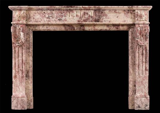 A Fior di Pesco marble Louis XVI fireplace